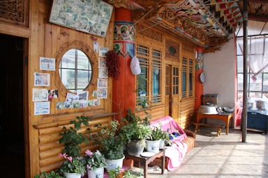 Enclosed porch of a Tibetan style family house©Ken Woolfenden